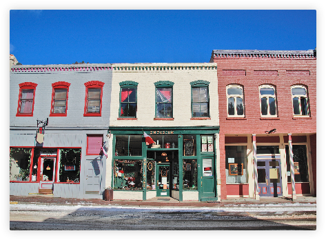 Colorful two story buildings with storefronts